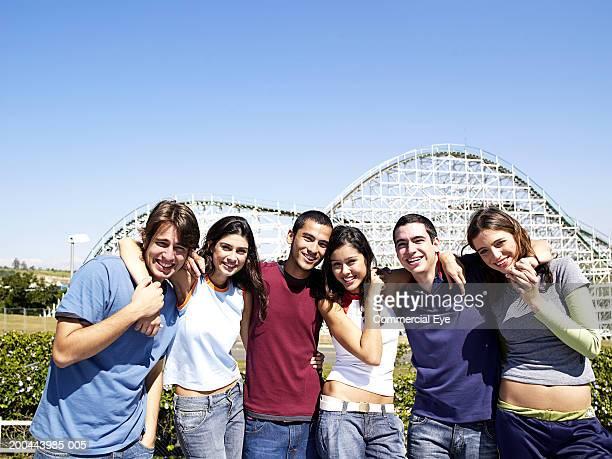 Young people at amusement park, portrait