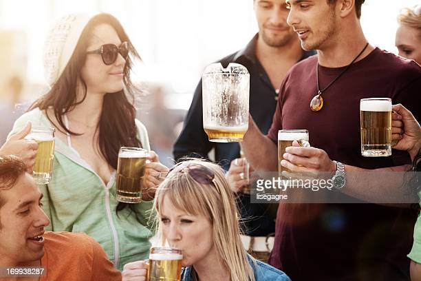 Young people at bistro having beer