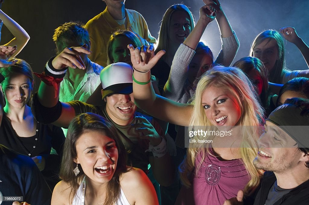 Young people at dance club : Stock Photo