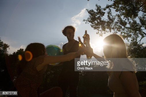 Young People at the Park, cheering with Beer. : Stock Photo