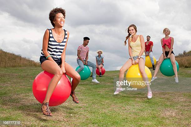 Young people bouncing on hoppity horses