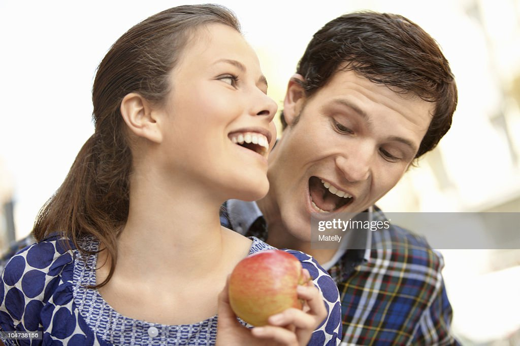 Young people buying fruits and vegetable : Stock Photo
