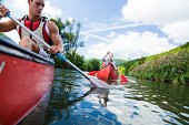 young people canoeing on the neckar river in germany.   see more similar images:   [url=search/portfolio/248175/?facets={%2235%22:%5B%22sports%22%5D,%229%22:0,%2230%22:%22100%22}][img]http://www.photo