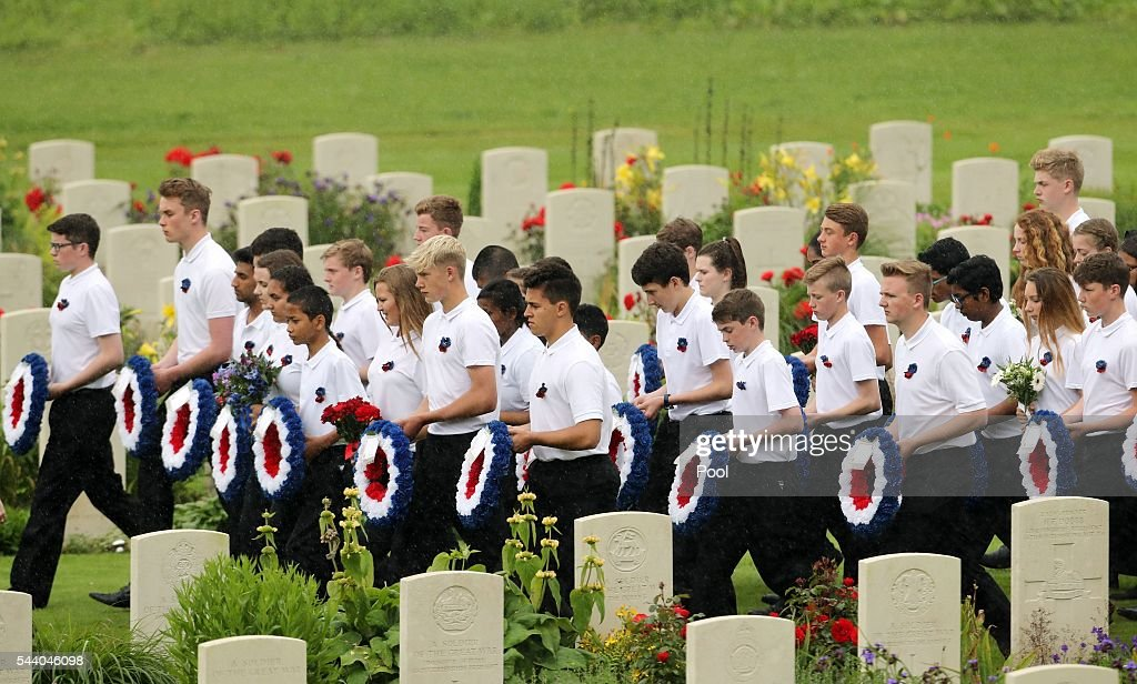 Young people carry wreaths at a service to mark the 100th anniversary of the beginning of the Battle of the Somme at the Thiepval memorial to the Missing on July 1, 2016 in Thiepval, France. The event is part of the Commemoration of the Centenary of the Battle of the Somme at the Commonwealth War Graves Commission Thiepval Memorial in Thiepval, France, where 70,000 British and Commonwealth soldiers with no known grave are commemorated.