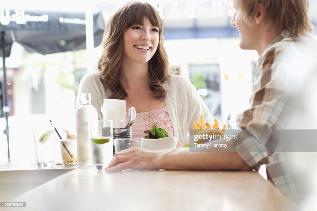 Young people chatting in restaurant : Stock-Foto