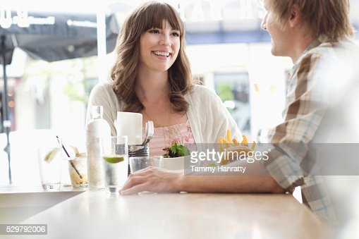 Young people chatting in restaurant : Stock Photo