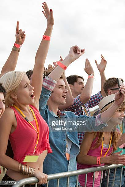 Young people cheering at festival
