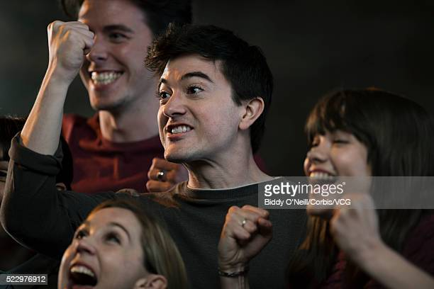 Young people cheering