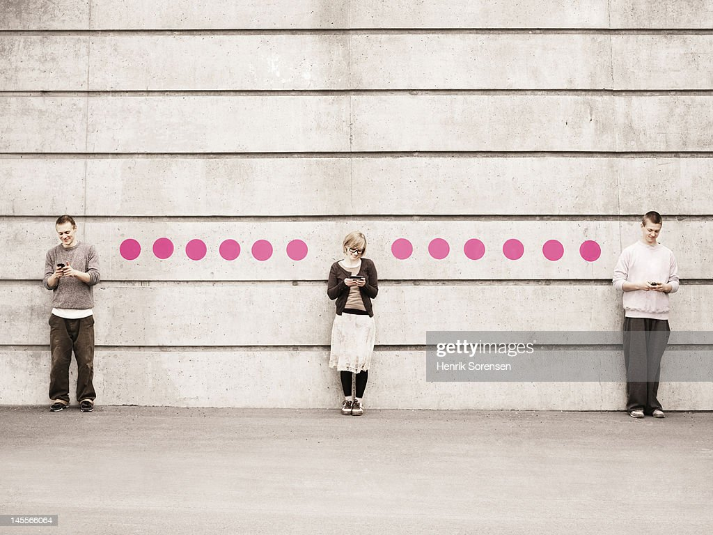... shot of young shy man and woman standing face to face and smiling