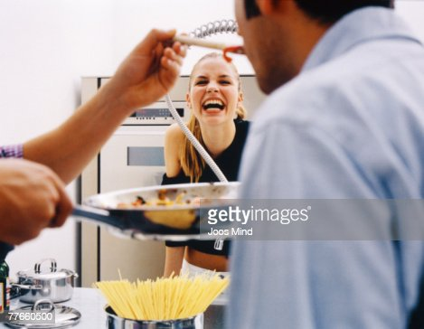 Young people cooking : Stock Photo