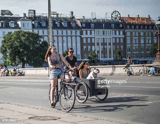 Young people cycling on Dronning Louises Bro, Copenhagen, Denmark