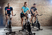 Young people cycling workout with rhythm of powerful music