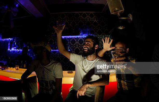 Young people dance at a nightclub in downtown Damascus on September 12 2013 When night falls in Damascus gaggles of determined revellers still head...