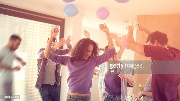 Young people dancing at a party