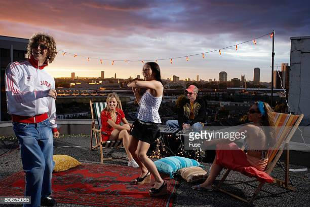 Young People Dancing at a Rooftop Party