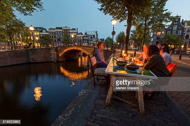 Young people dining along Reguliersgracht