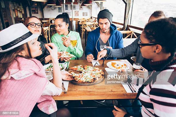 Young people dining together in a restaurant