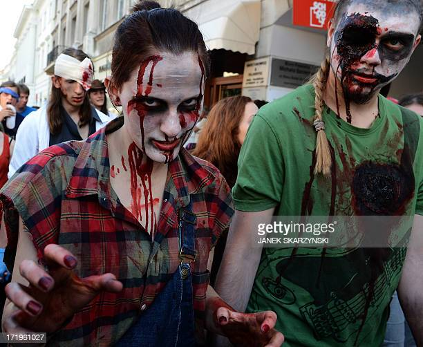Young people dressed as zombies walk the streets in Warsaw Poland on June 29 2013 as a tribute to Michael Jackson's iconic 'Thriller' video AFP...
