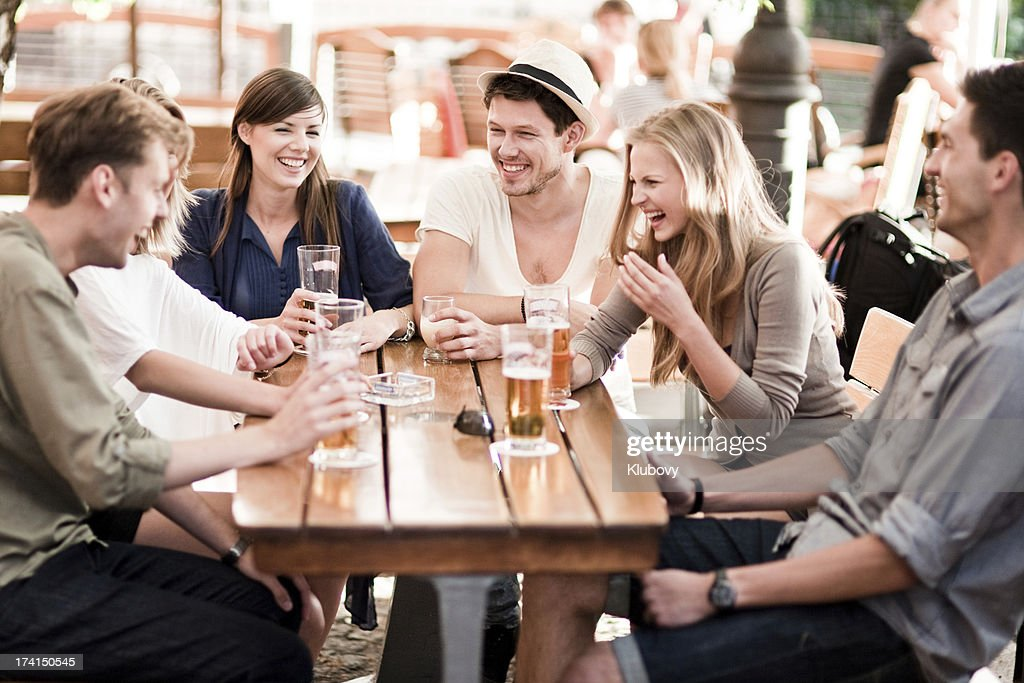 Young people drinking beer outdoors : Stock Photo