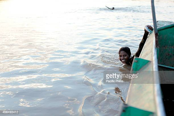 Young people enjoy swimming in the Omo River as one of the water source for Gibe III Dam Gibe III Dam Africas Tallest Dam with installed capacity of...