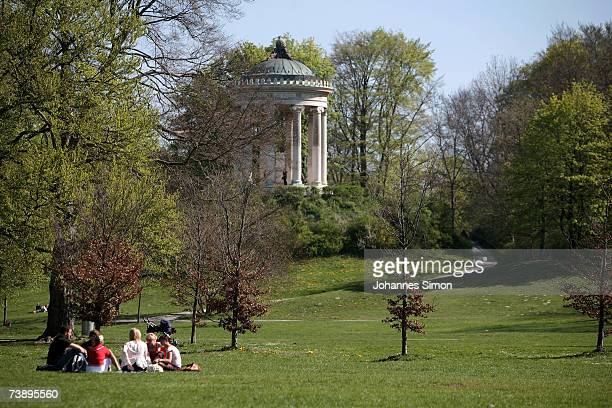 Young people enjoy the warm weather in front of the Monopteros in the world famous Englischer Garten on April 16 in Munich Germany The unseasonably...