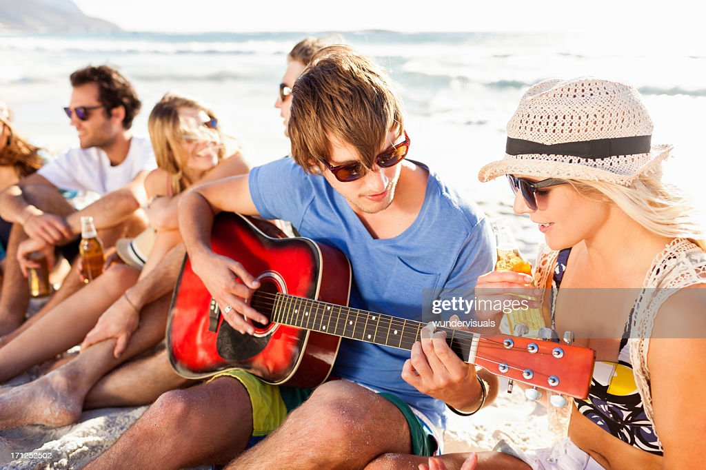 Young People Enjoying A Beach Party : Stock Photo