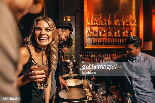 Young people enjoying a night at club : Stock Photo