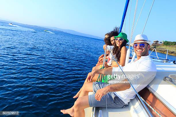 Young people enjoying a yacht ride