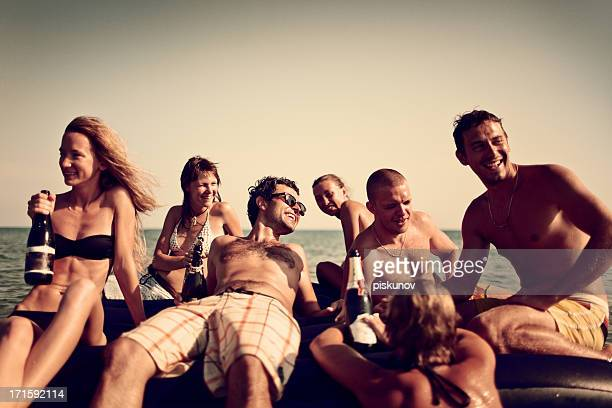 Young People Enjoying Beach Party