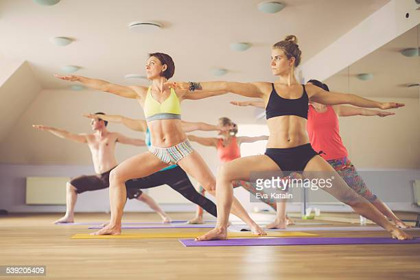 Young people exercising yoga