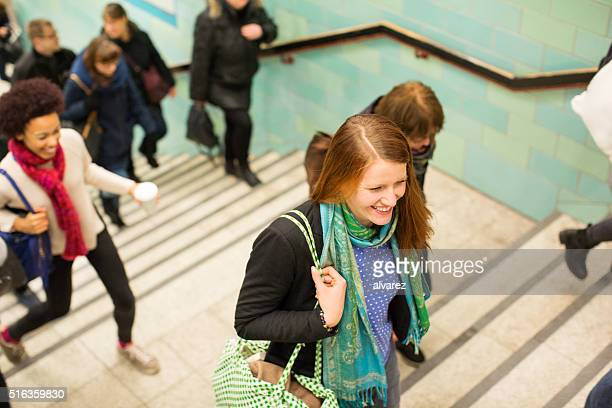Young people exiting the subway