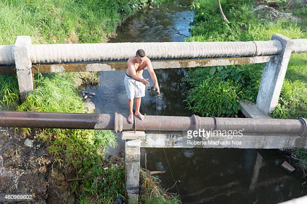 Young people fishing in a river as a way to pass time in Santa Clara city