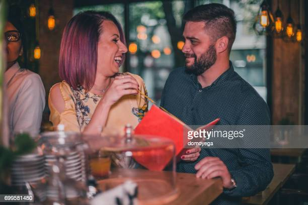 Young people flirting at the bar