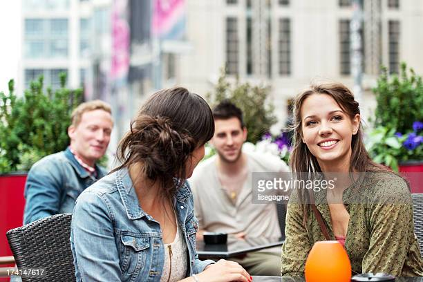 Young people flirting on a sidewalk cafe