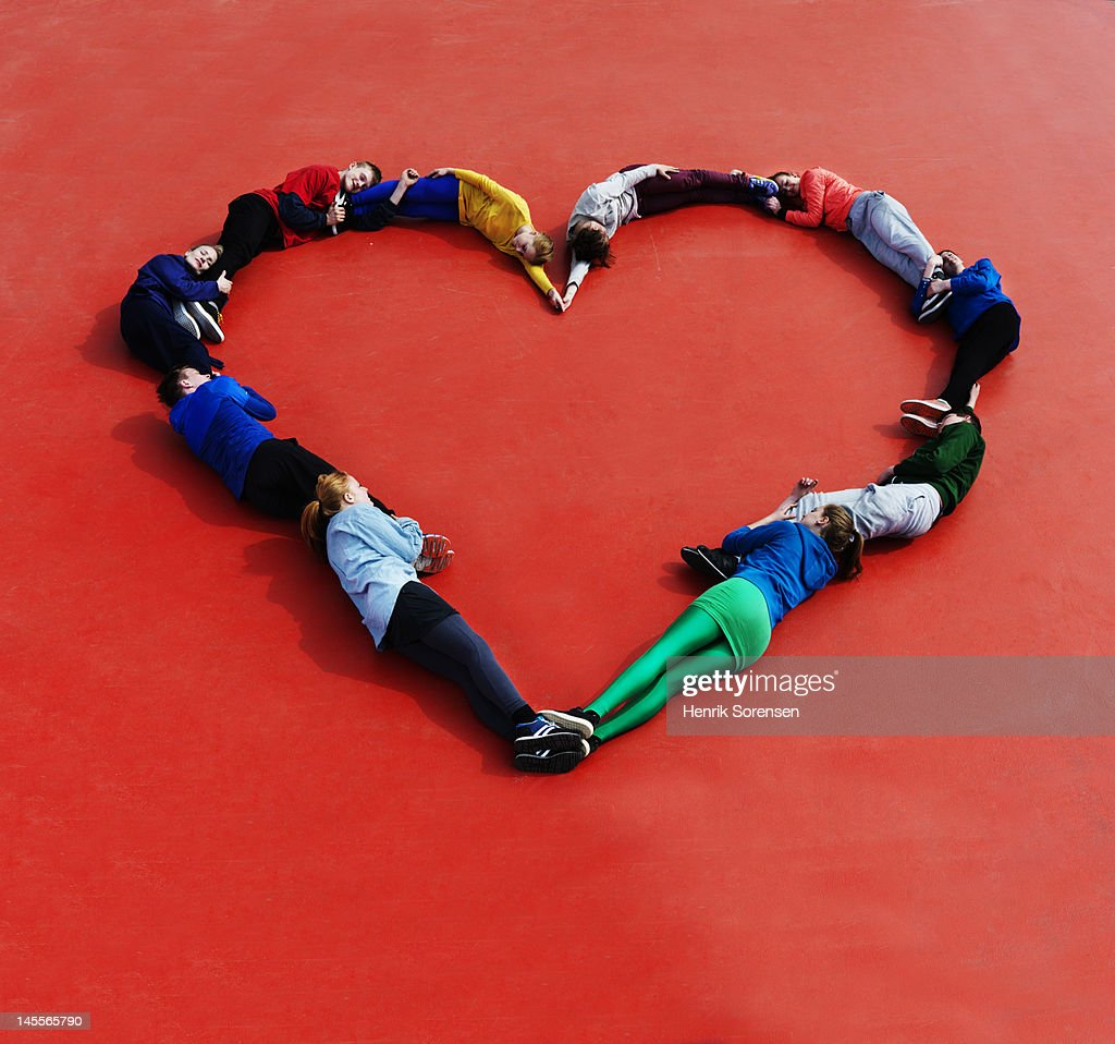 Young people form a heart