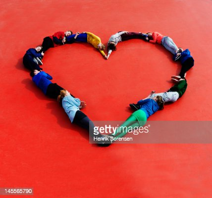 Young people form a heart : Stock Photo