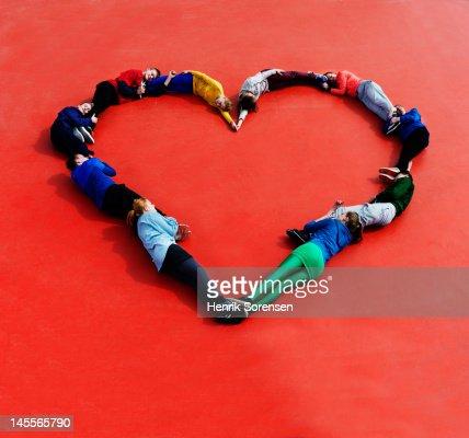 Young people form a heart : Bildbanksbilder
