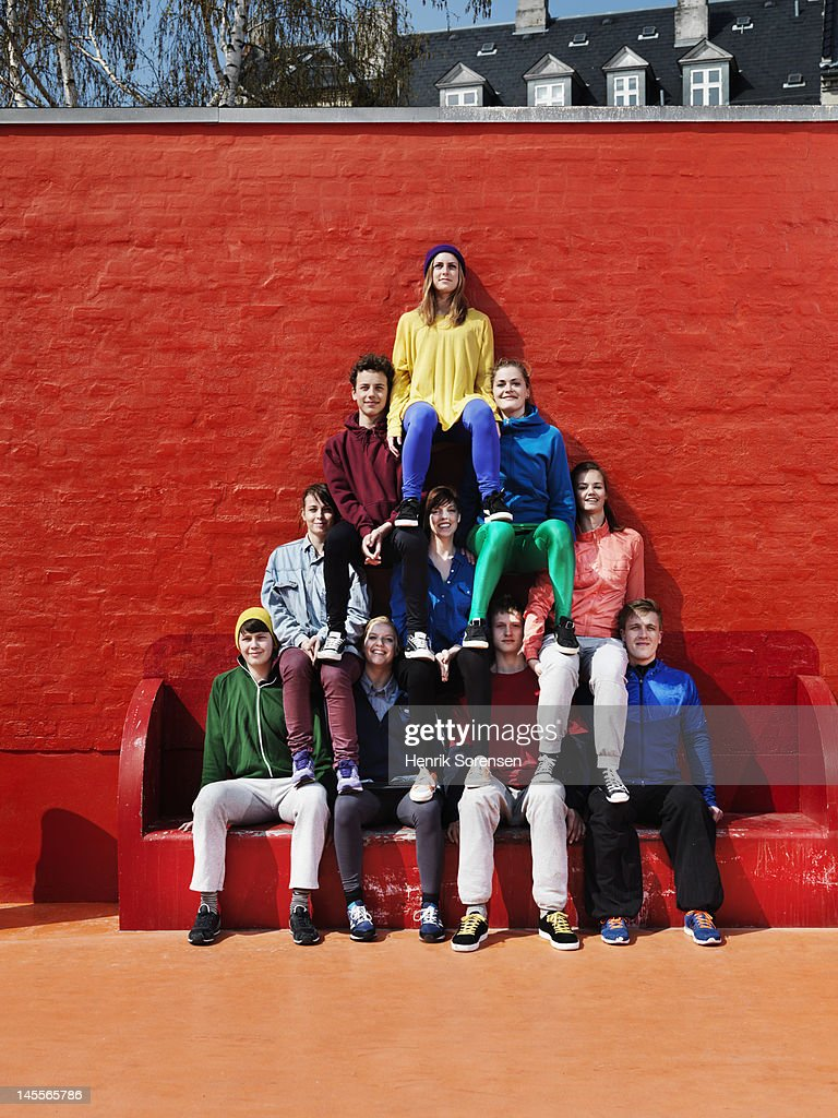 Young people forming a pyramid
