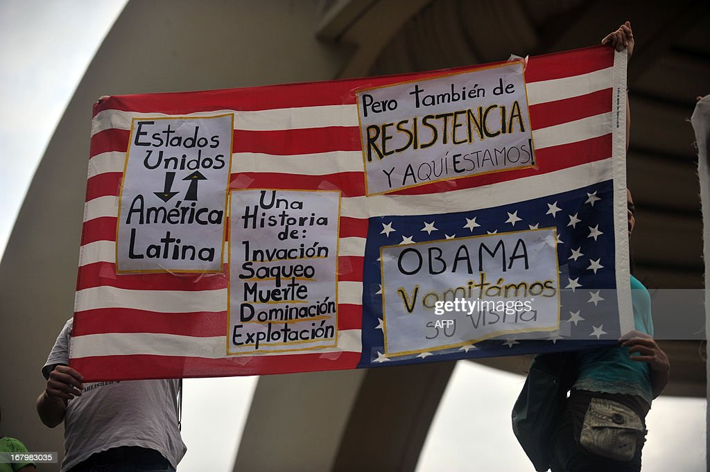 Young people from leftist political parties and university students protest in the Central Park in San Jose, on May 3, 2013, against the visit of U.S. President Barack Obama, who is participating in the summit of leaders of countries belonging to the SICA. Obama visited Costa Rica on Friday for a Central American summit focused on trade and the drug war after a stop in Mexico highlighting economic and security ties.AFP PHOTO/Hector RETAMAL