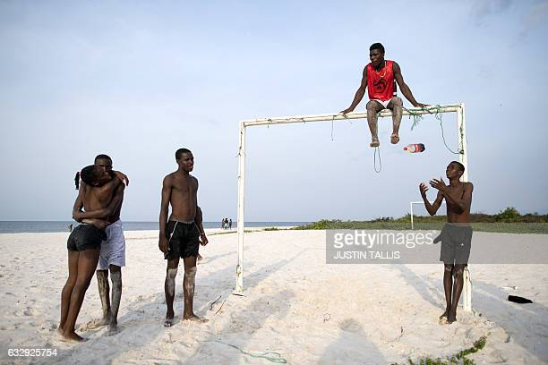 Young people hang out by a football goal on Sogara beach in PortGentil on January 28 during the 2017 Africa Cup of Nations football tournament in...