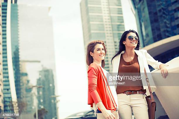 Young people  hanging out against cityscape
