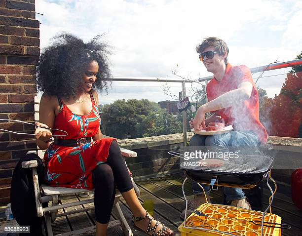 Young people having a barbecue