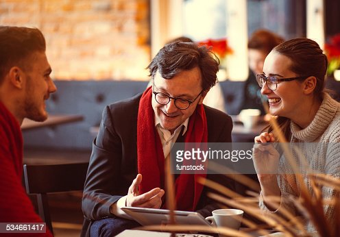 Young people having a business meeting at the coffee bar