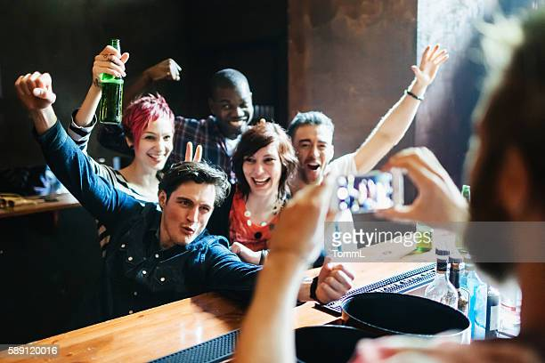 Young people having a party in a bar