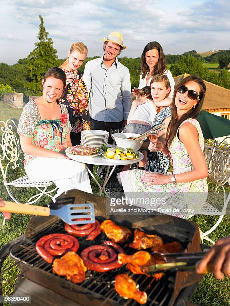 young people having barbecue
