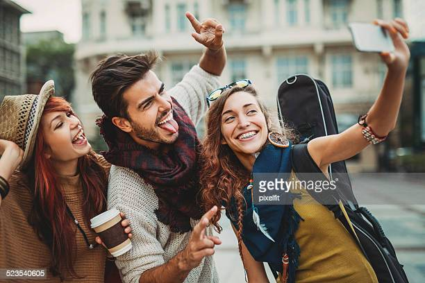 Young people having fun and making selfie