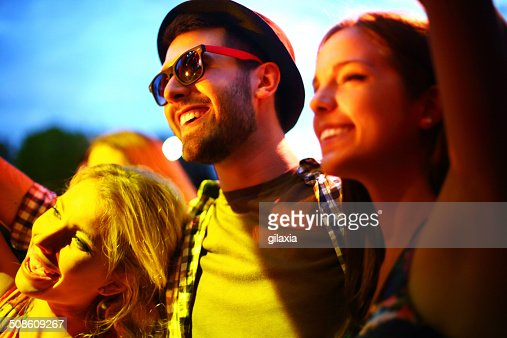Young people having fun at concert. : Stock Photo