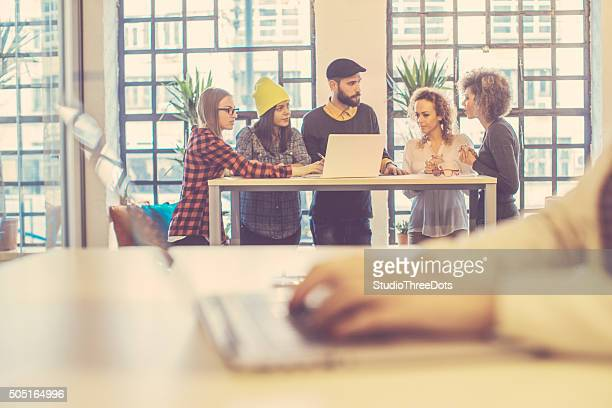 young people having meeting at the office