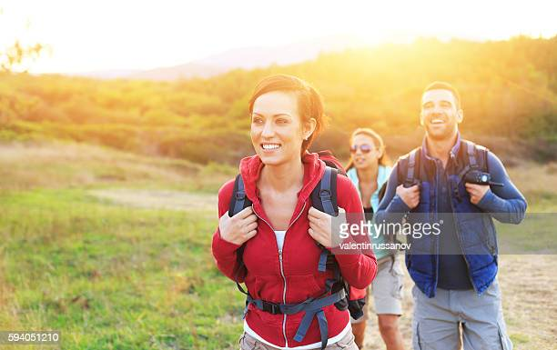 Young people hiking in the mountain