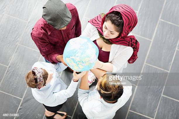 young people holding globe earth